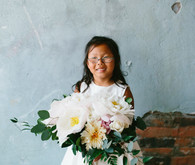 flower girl with brides bouquet