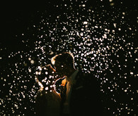 nighttime confetti wedding portrait
