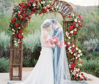 Red floral wedding arbor
