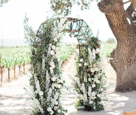 White and green floral arch