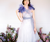 Monique Lhuillier wedding dress with I Do Style Collective feathers