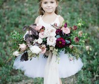 Flower girl with flower crown and bouquet