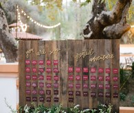 Wood place card display with burgundy place cards