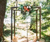 Ceremony arch with peonies