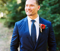 groom in blue suit