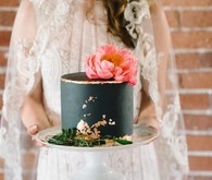 black wedding cake with coral peony