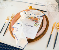 Gold and wood place setting