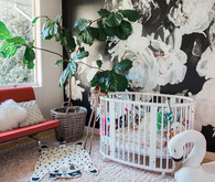 modern girl's nursery with floral wallpaper