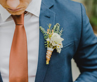 Blue groom's suit with copper tie