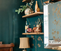 Emerald wall with open shelving