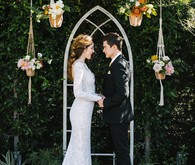 eclectic ceremony decor with macrame plant holders