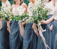 Bridesmaids in blue skirts