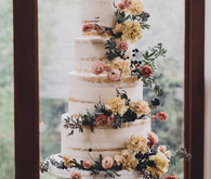 Tiered layer cake with strawflowers and chrysanthemums