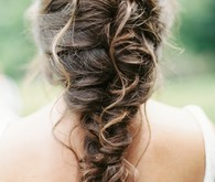 bride with a messy braid