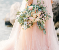 Blush bridal gown and pastel bouquet