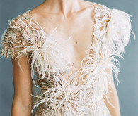 white feather wedding dress