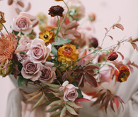 Muted jewel tone floral arrangement