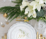 Elegant holiday place setting with Teleflora on 100 Layer Cake