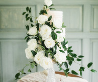 Elegant floral winter wedding cake on 100 Layer Cake