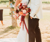 Groom in white dinner jacket at Flora Farms wedding on 100 Layer Cake