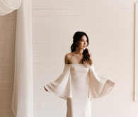 Bell sleeved bridal gown