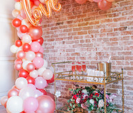 balloon arch and bar cart