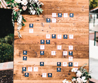 Wood and copper escort card wall
