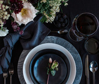 Dark and moody floral place setting with Crate and Barrel