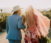 Rustic Joshua Tree wedding with a pink floral dress