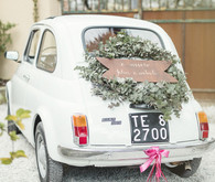Vintage fiat wedding getaway car