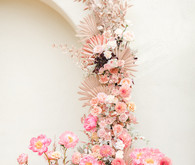 Colorful modern wedding with a killer tropical floral installation
