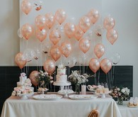 Pink baby shower with lots of balloons