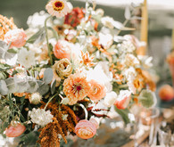 late summer flower arrangement in terracotta and peach