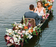wedding portrait in a floral canoe