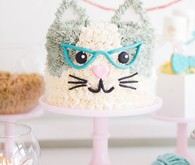 A kitty cat second birthday party with the most incredibly fun decor