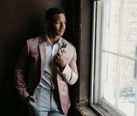 Fashion-forward groom style with a mauve jacket