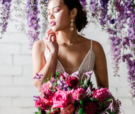 Bright moody spring wedding inspo with a dramatic floral curtain