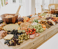 amazing grazing table for an all white bridal shower