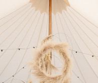 wedding tent with pampas grass wreaths