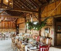 Farm to table summer barn wedding with pops of red and a PARADE