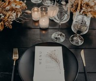 black place setting with dried flowers