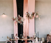 Black, gold, and pink wedding backdrop