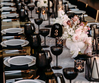 Black, gold, and pink tables cape
