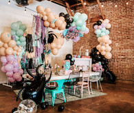 Pastel balloon and fringe backdrop for Halloween