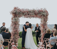 Pink babies breath wedding arch