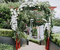 Green and white wedding arch