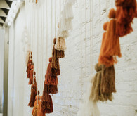 Yarn tassel backdrop