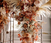 Lush fall floral ceremony arch with pampas