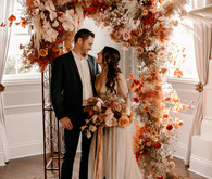 Lush fall floral ceremony arch