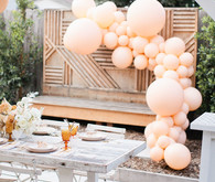 Peach balloon installation for baby shower
